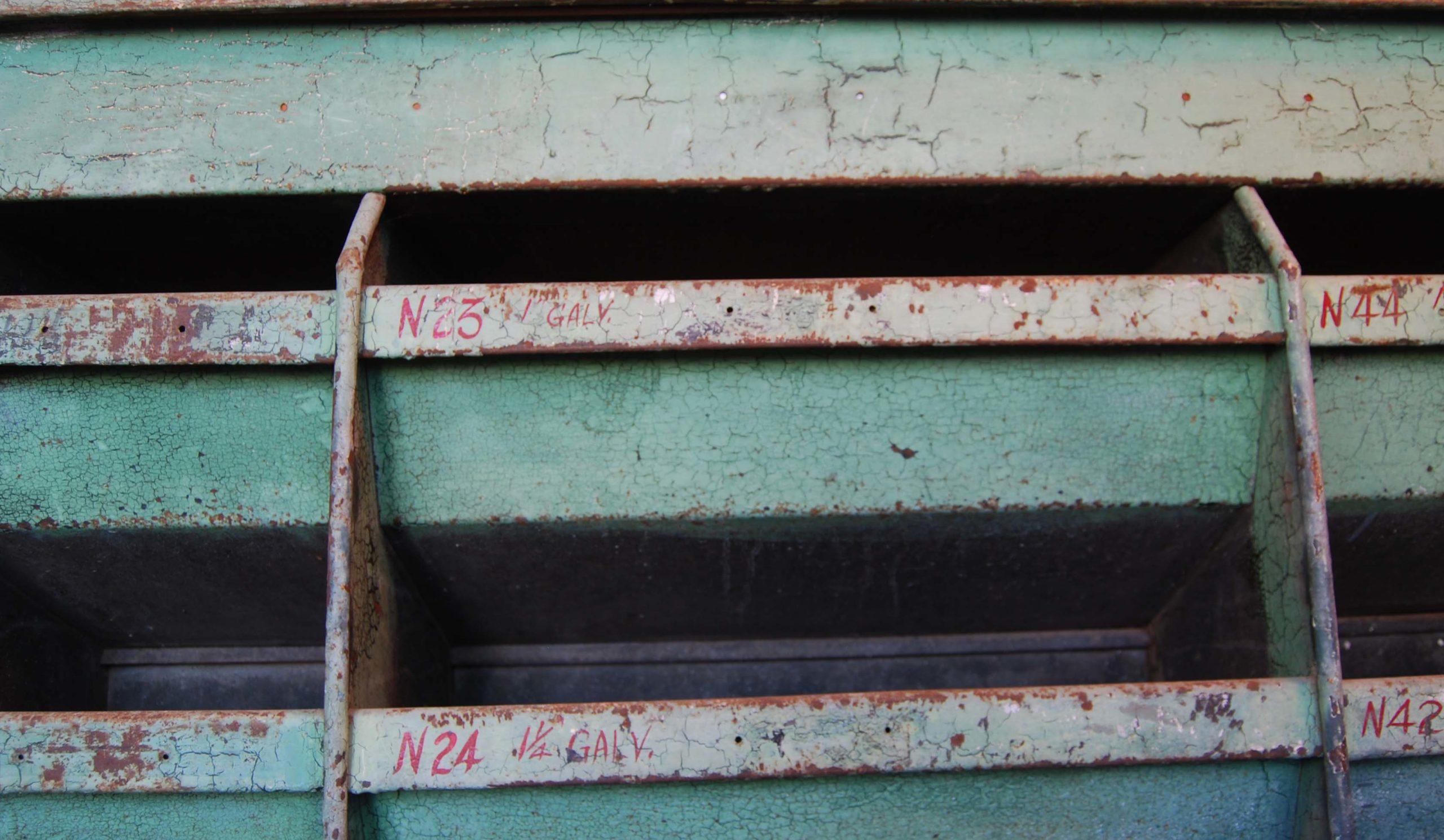 A painted steel industrial parts bin-112596