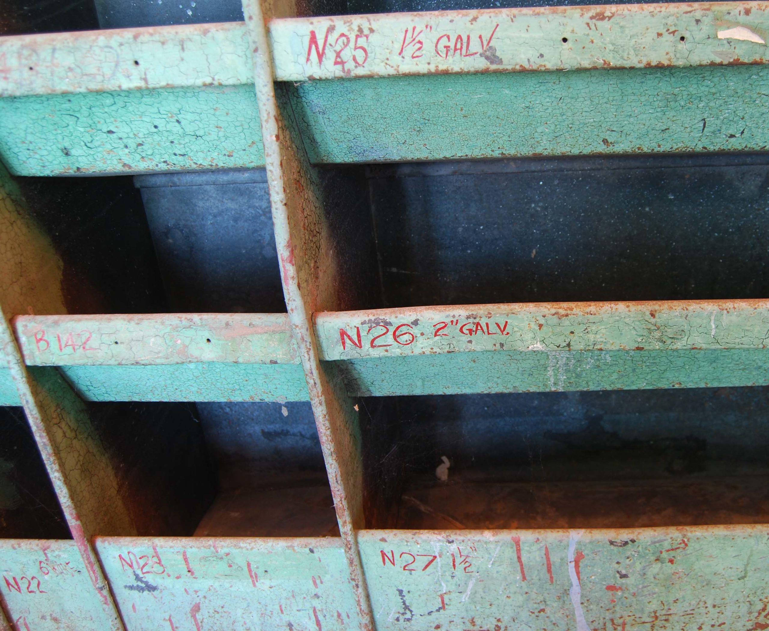 A painted steel industrial parts bin-112597