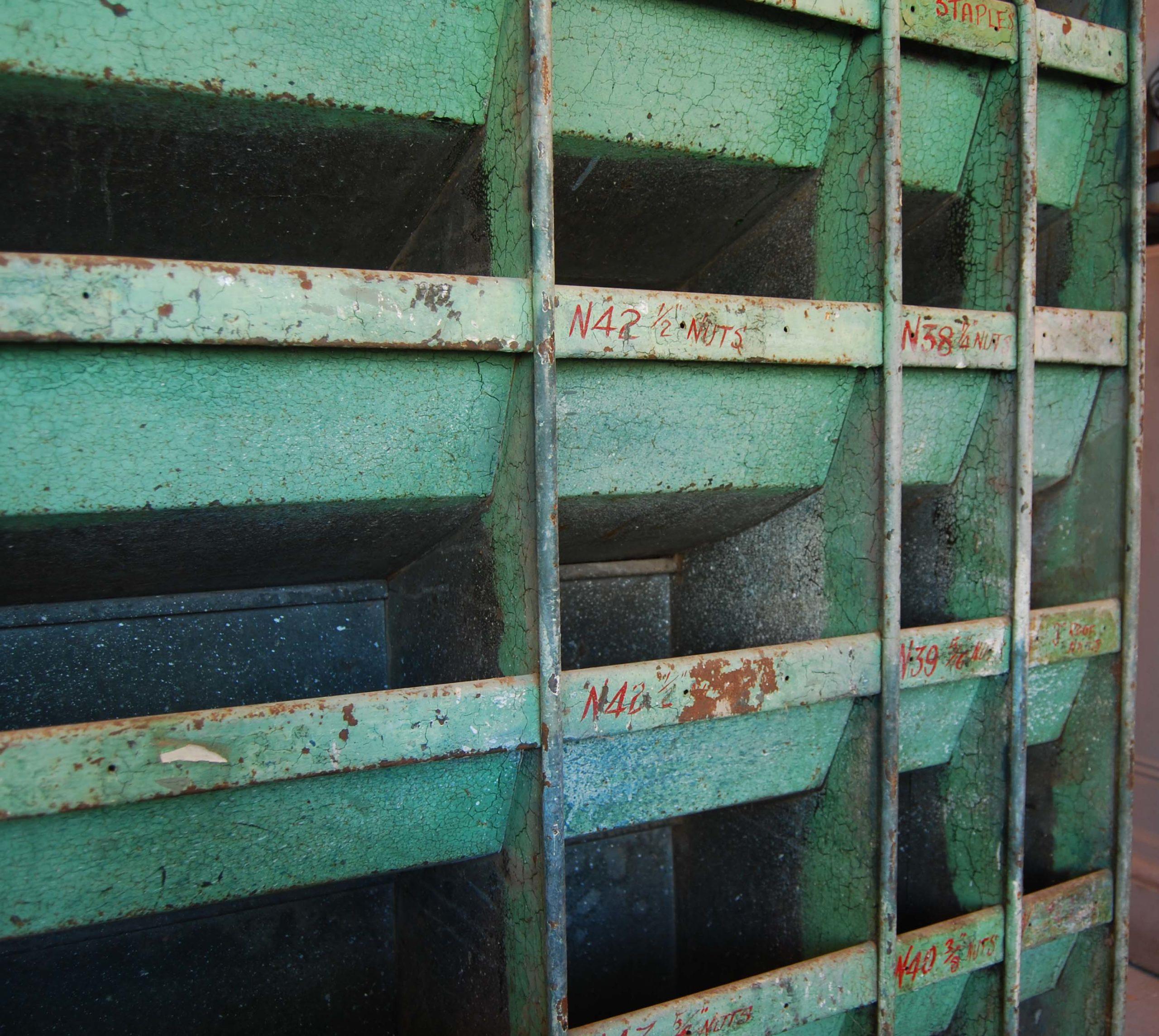 A painted steel industrial parts bin-112595