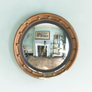 Regency style gilt convex wall mirror,-0