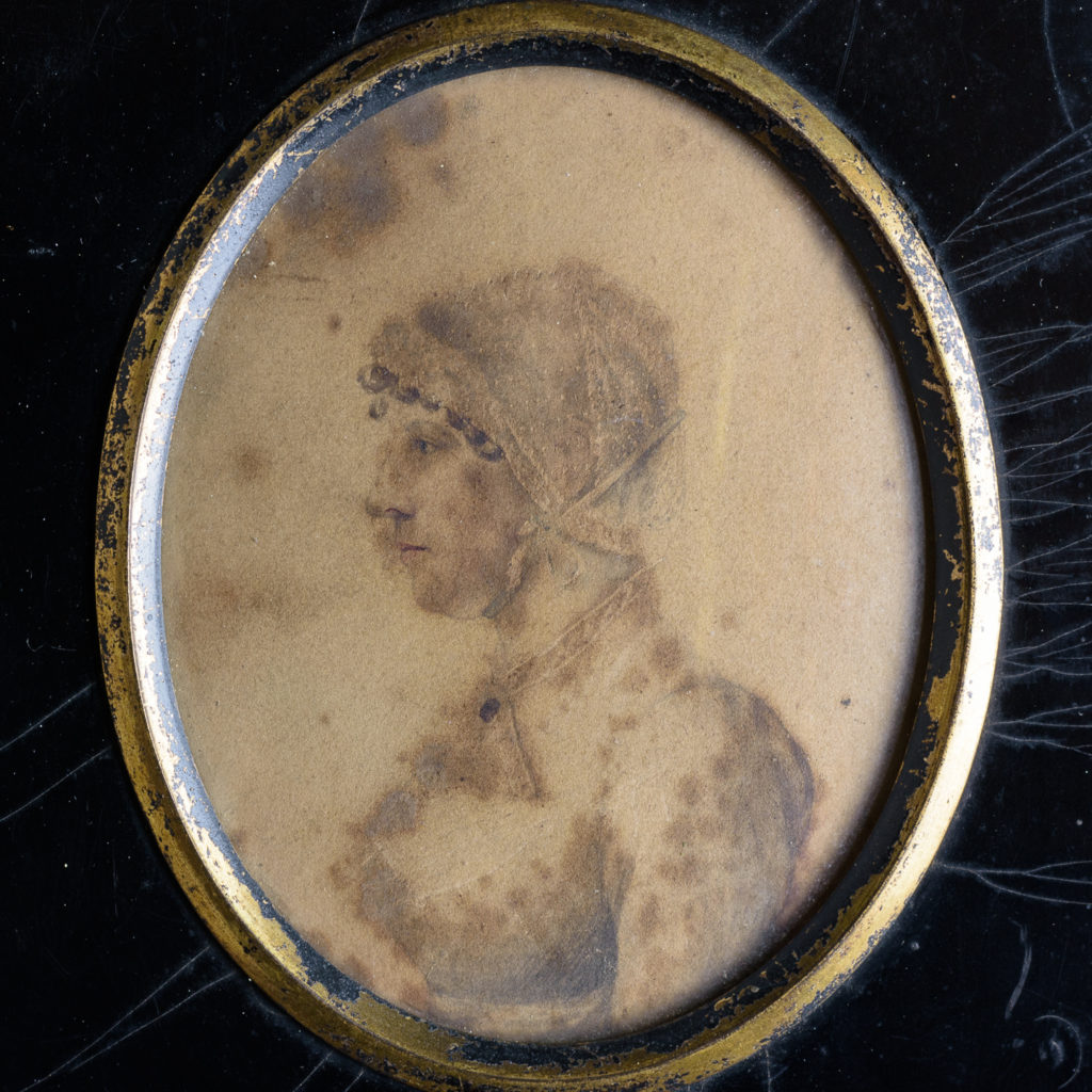Oval portrait miniature of a lady wearing a bonnet-113210
