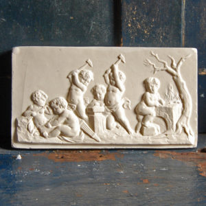An English relief-cast plaster plaque,-0