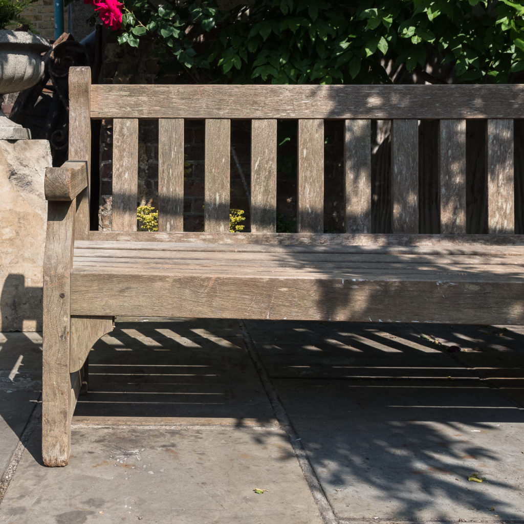A weathered teak bench,-115993