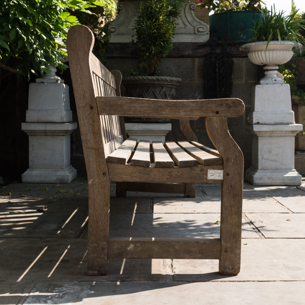 A weathered teak bench,-115988