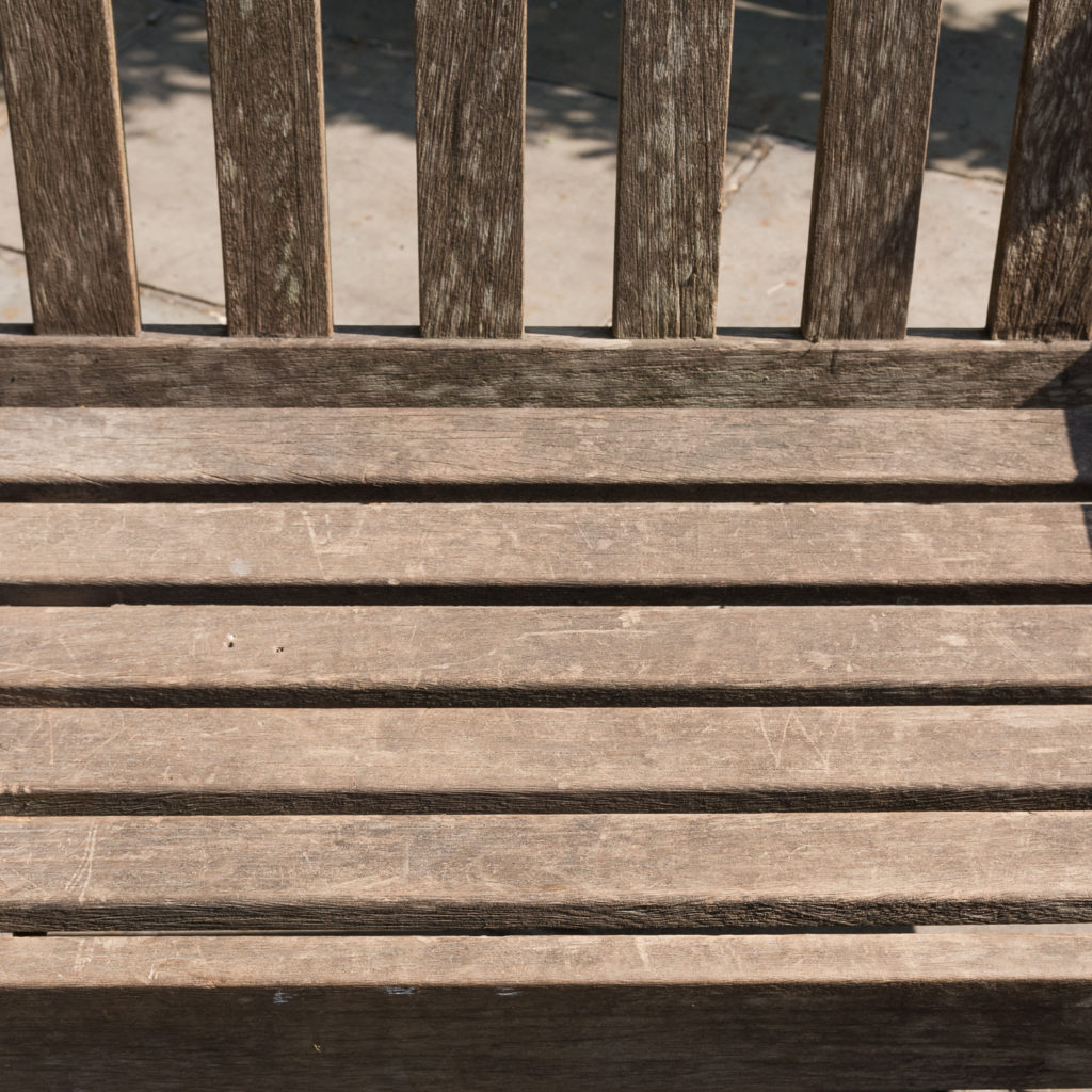 A weathered teak bench,-115989