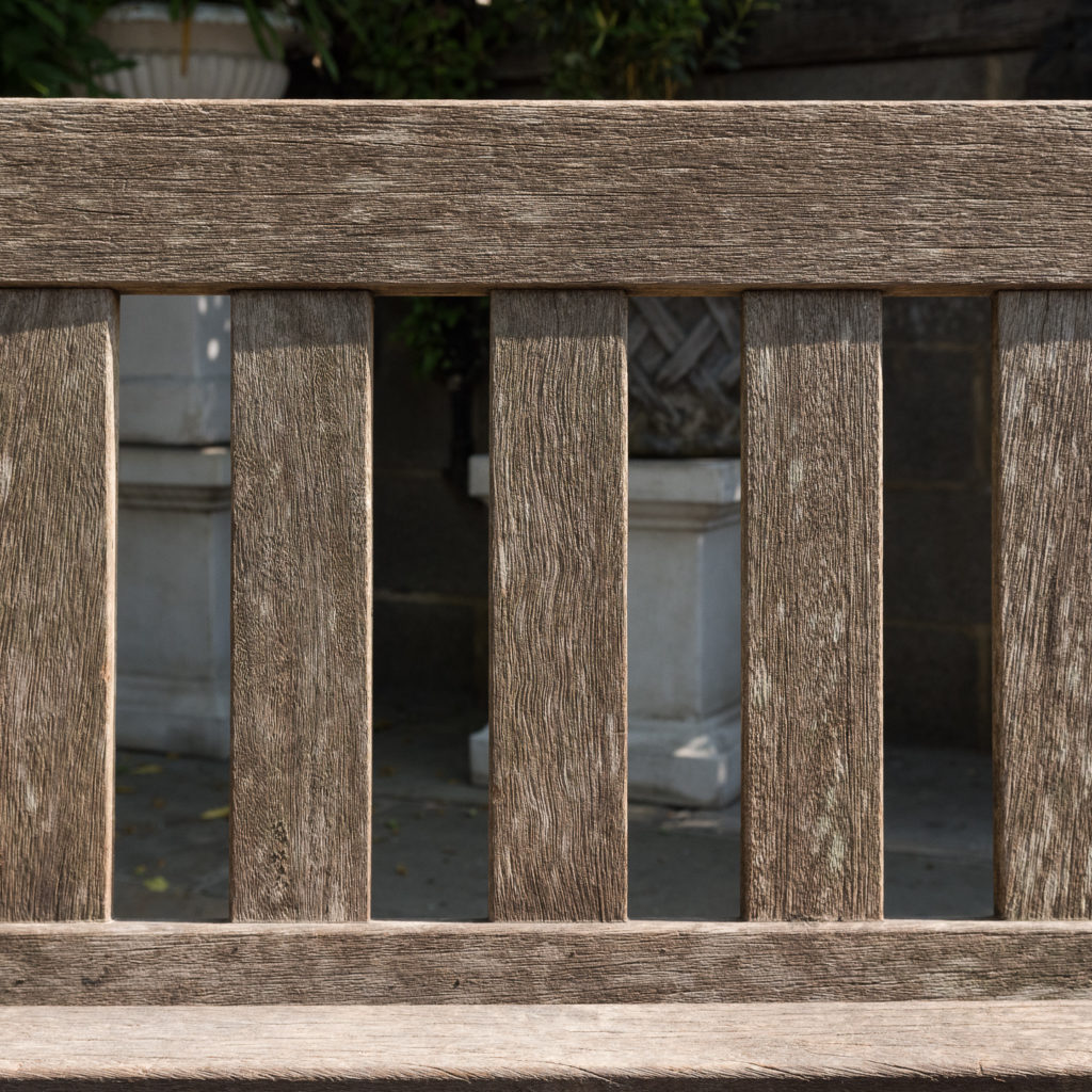 A weathered teak bench,-115990