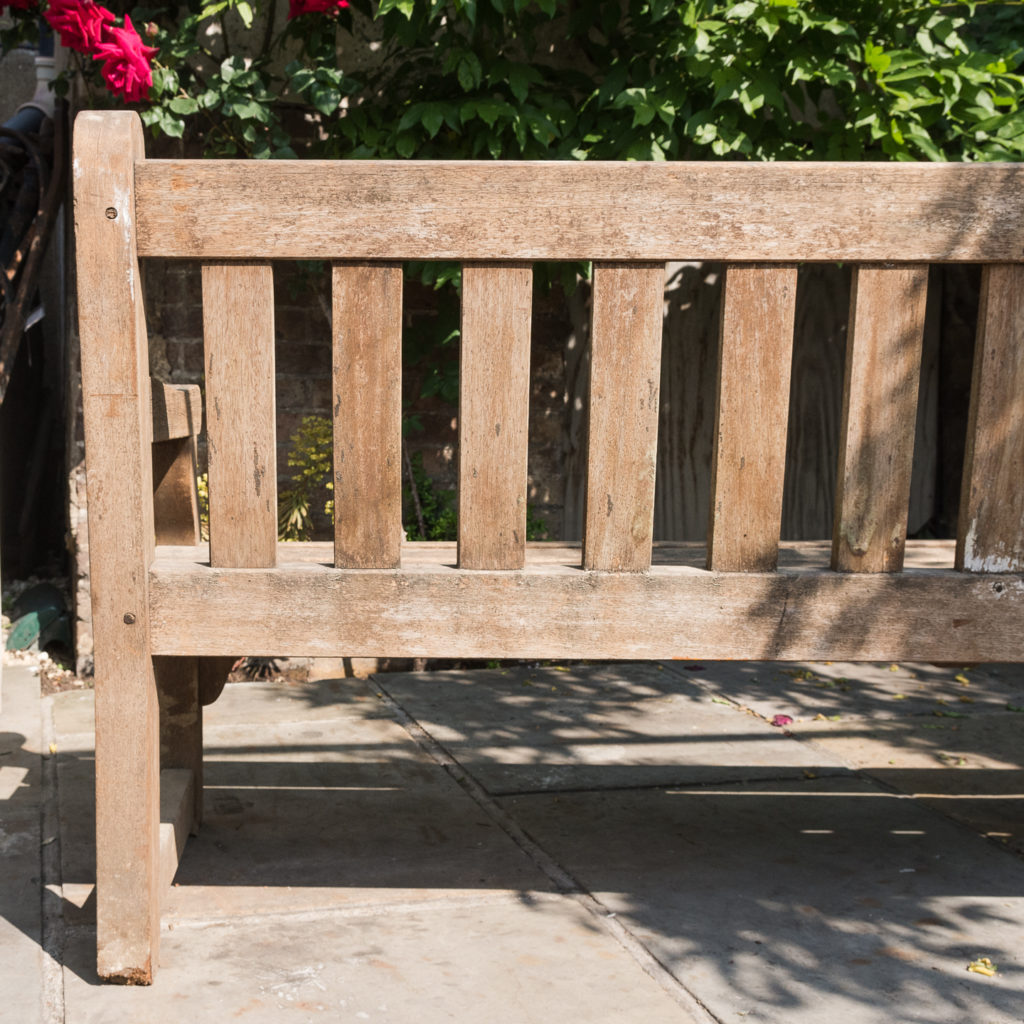 A weathered teak bench,-115991