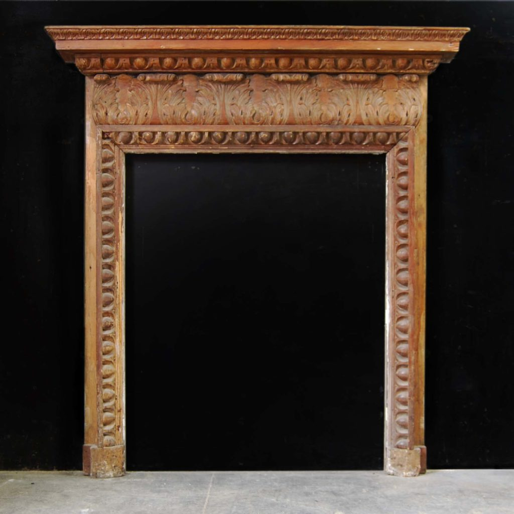 A carved pine chimneypiece in the Georgian taste-0