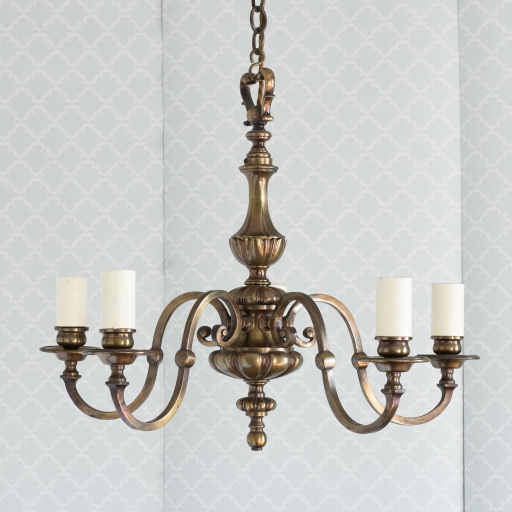 Three bronzed five light chandeliers, -0