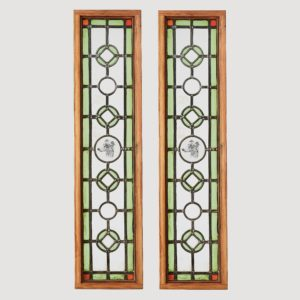 A pair of stained glass panels,-0