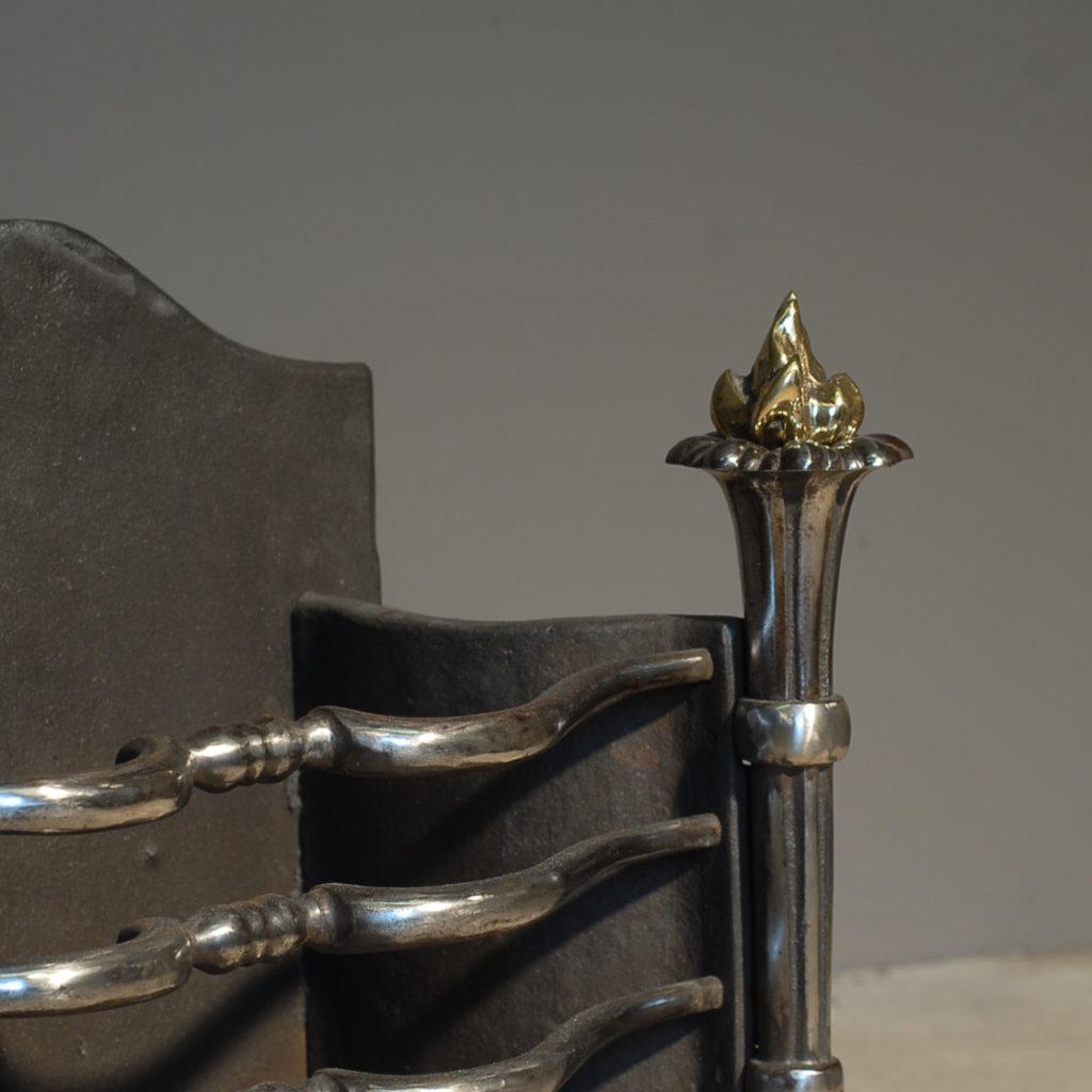 An English cast iron and brass firebasket-138661