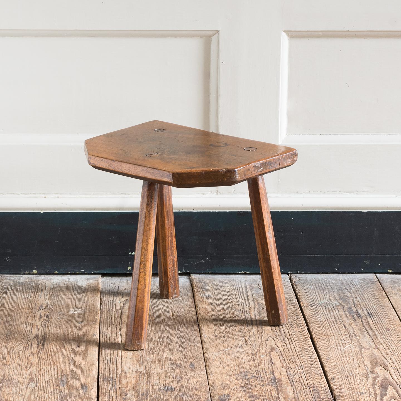 Walnut milking stool,