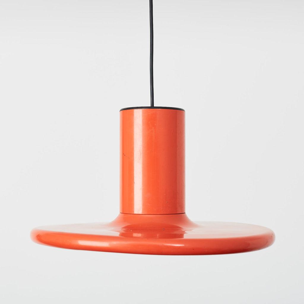 A pair of orange pendant lights by LITA,-121627