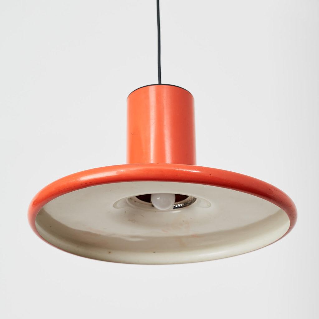 A pair of orange pendant lights by LITA,-121625