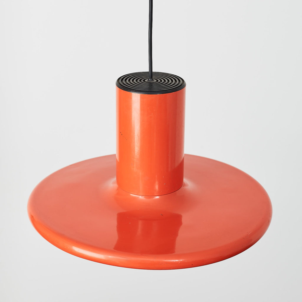 A pair of orange pendant lights by LITA,-121631