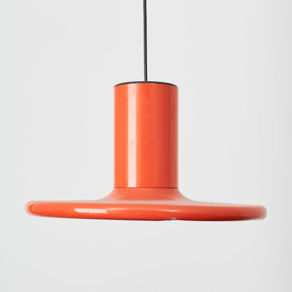 A pair of orange pendant lights by LITA,-121628