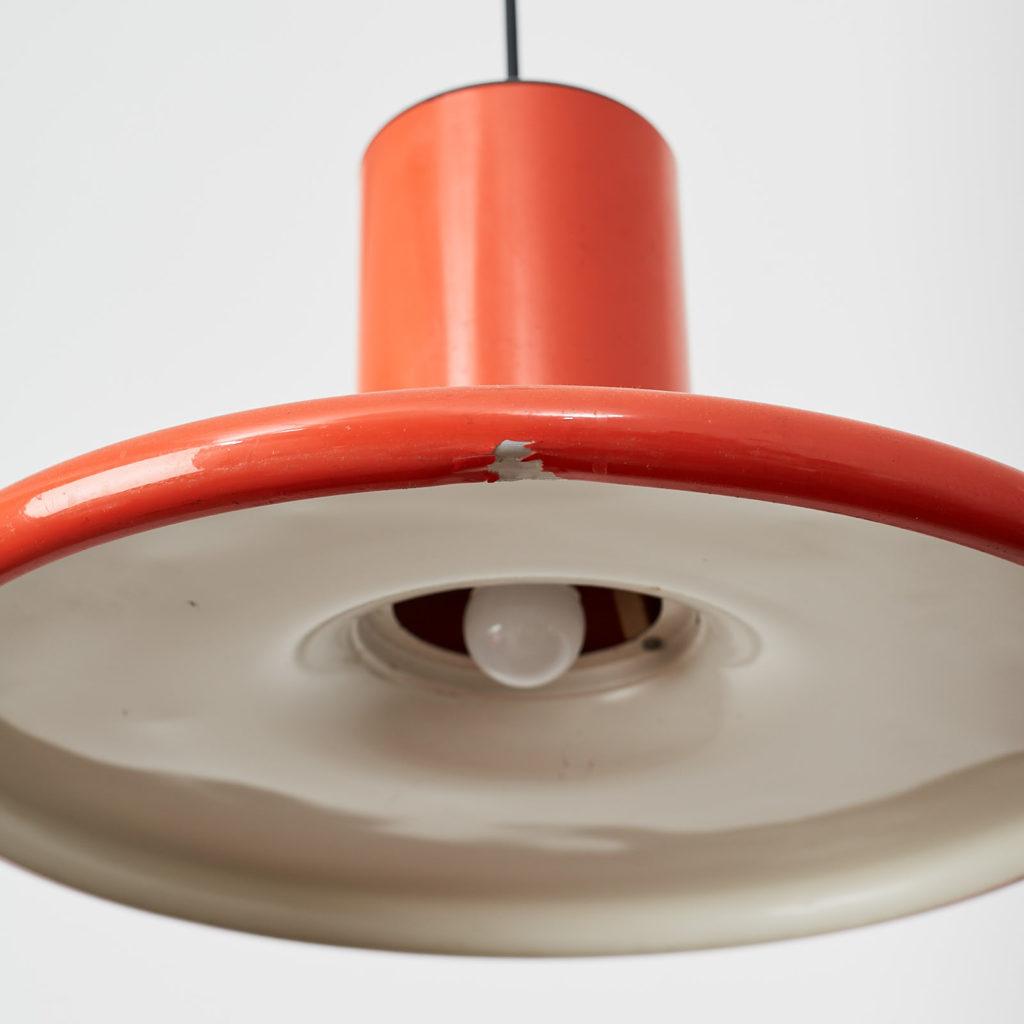 A pair of orange pendant lights by LITA,-121626