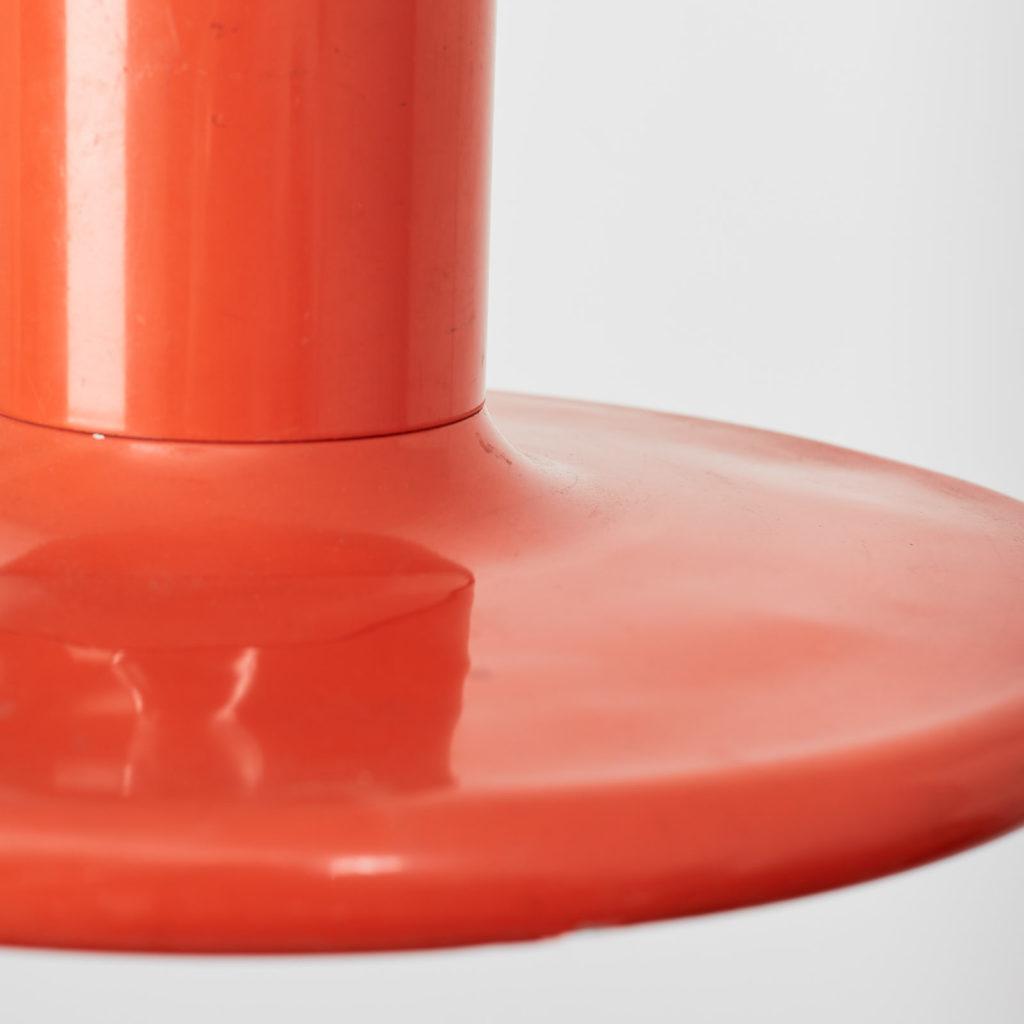 A pair of orange pendant lights by LITA,-121630