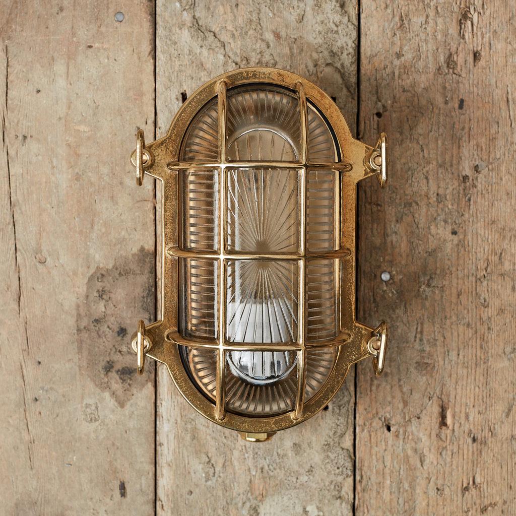 A polished brass bulkhead light,-0