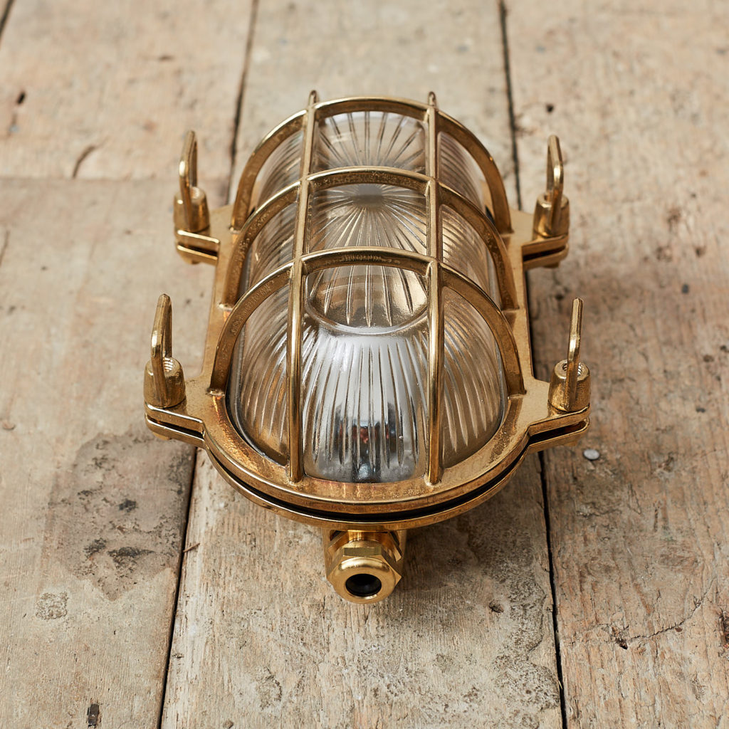 A polished brass bulkhead light,-121541