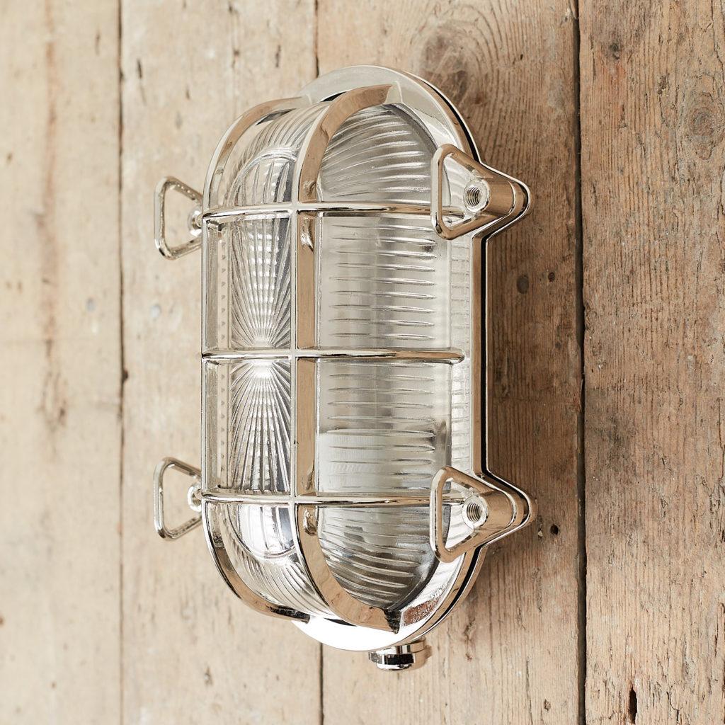 A polished nickel bulkhead light,-121565