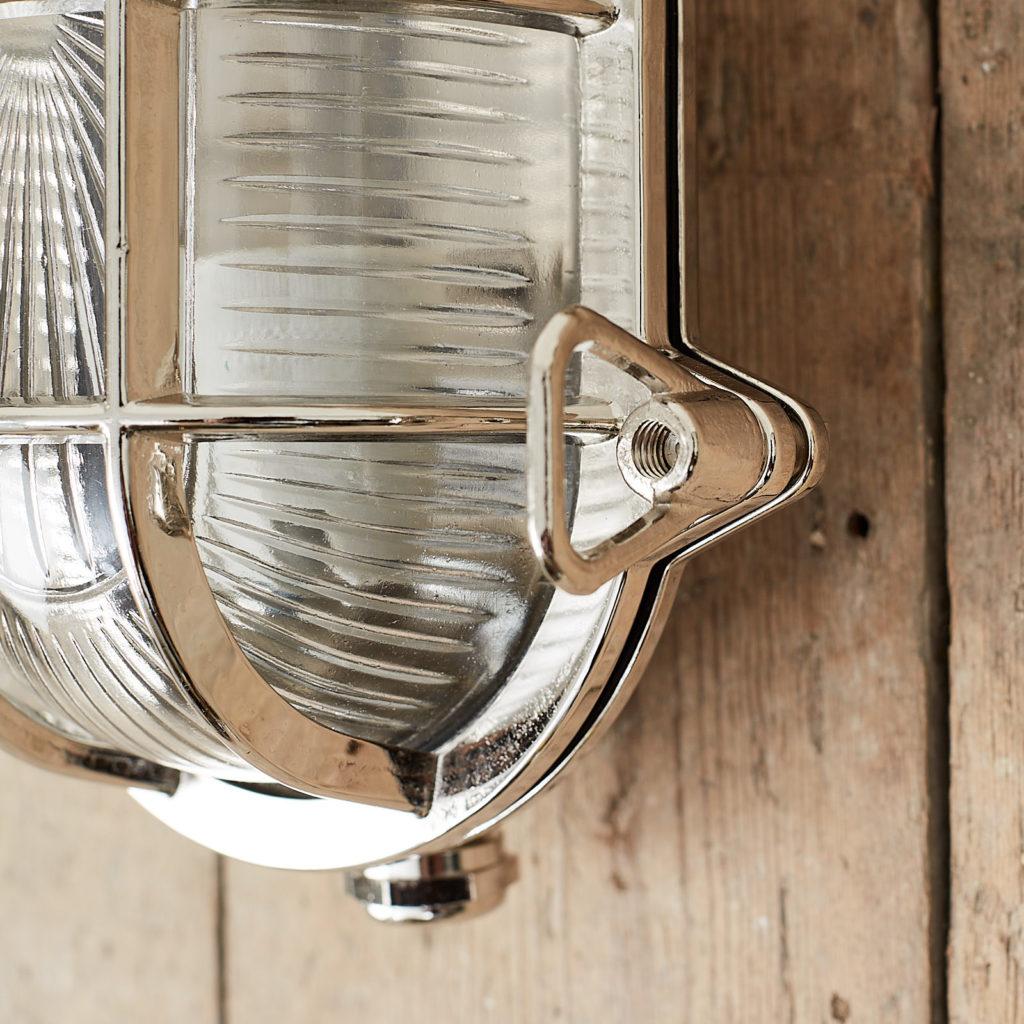 A polished nickel bulkhead light,-121562