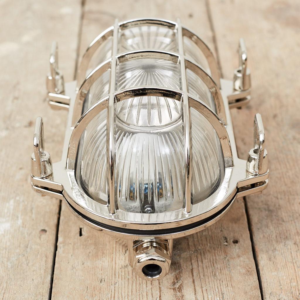 A polished nickel bulkhead light,-121567