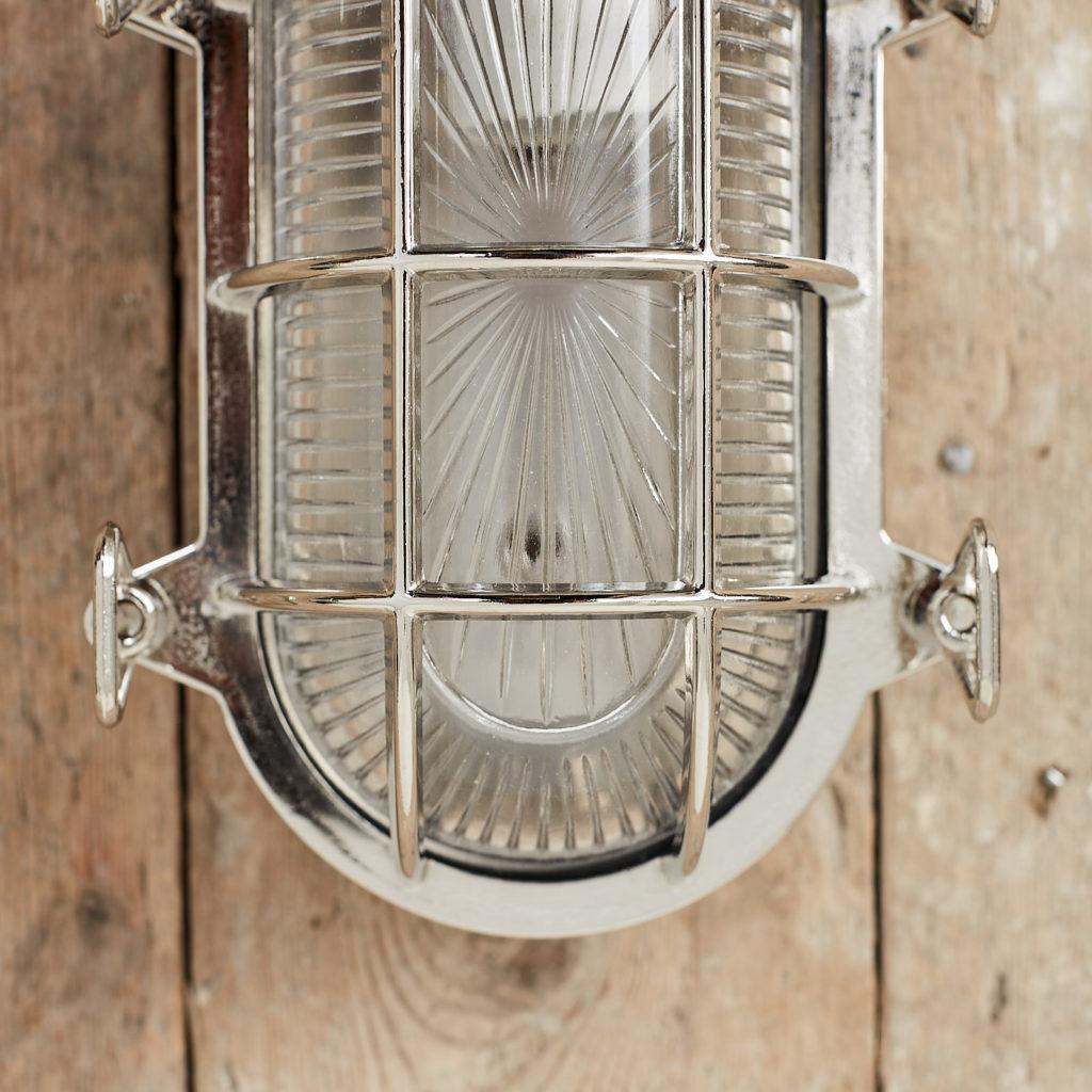 A polished nickel bulkhead light,-121563