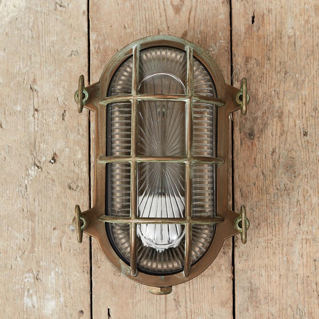 An aged brass bulkhead light,-0