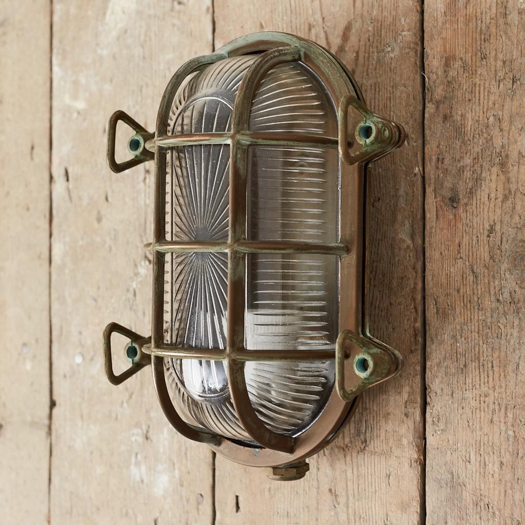 An aged brass bulkhead light,-121554