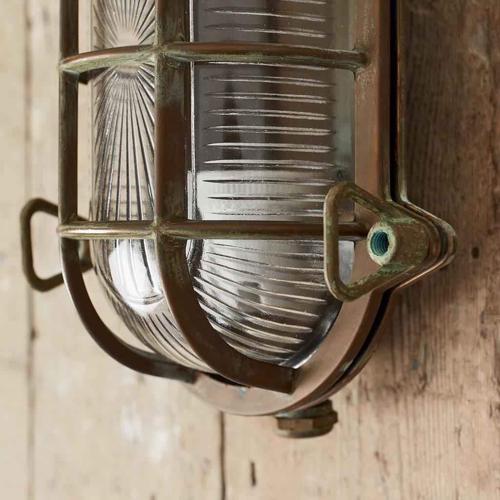 An aged brass bulkhead light,-121555