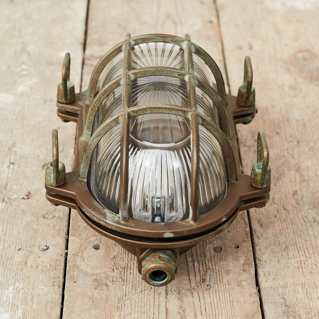 An aged brass bulkhead light,-121552