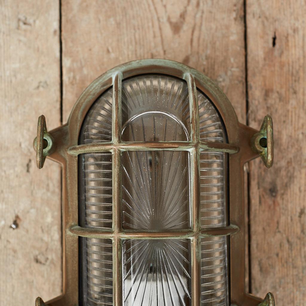 An aged brass bulkhead light,-121550