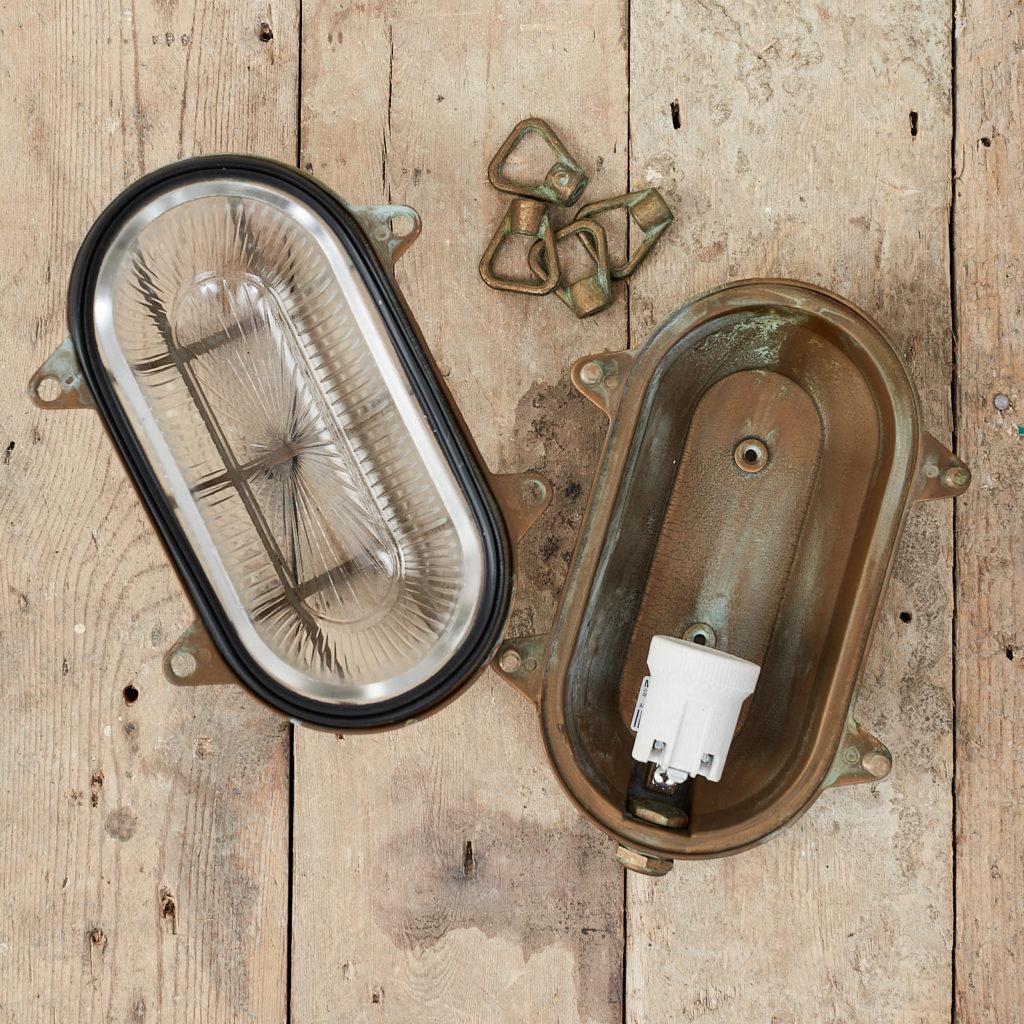 An aged brass bulkhead light,-121553