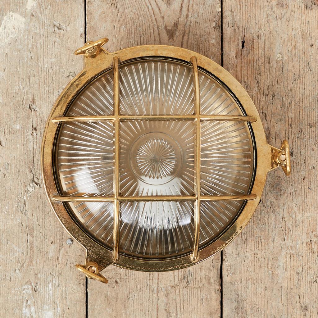 A round polished brass bulkhead light,-0