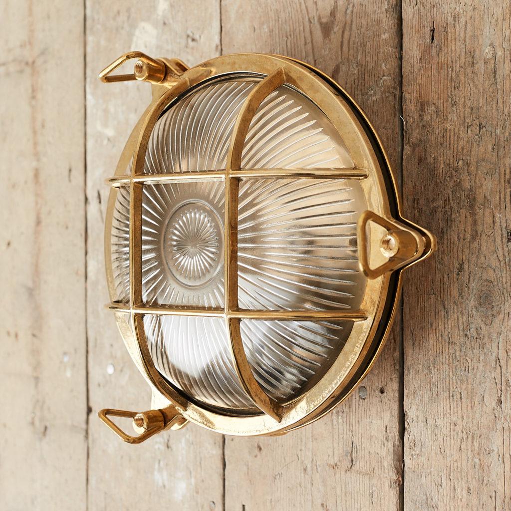 A round polished brass bulkhead light,-121576