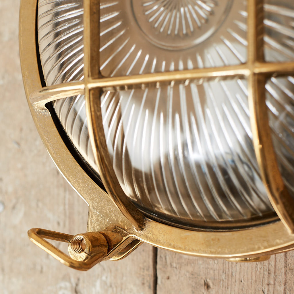 A round polished brass bulkhead light,-121574