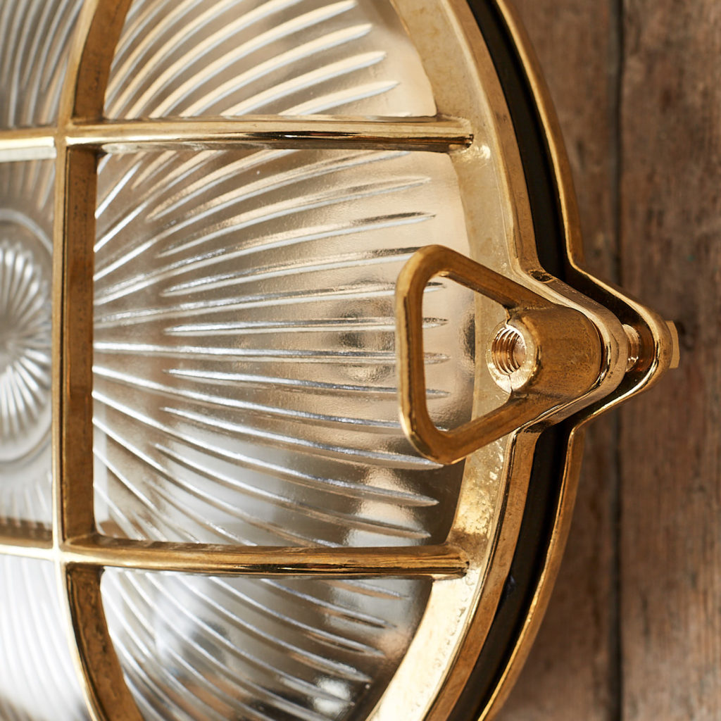 A round polished brass bulkhead light,-121580