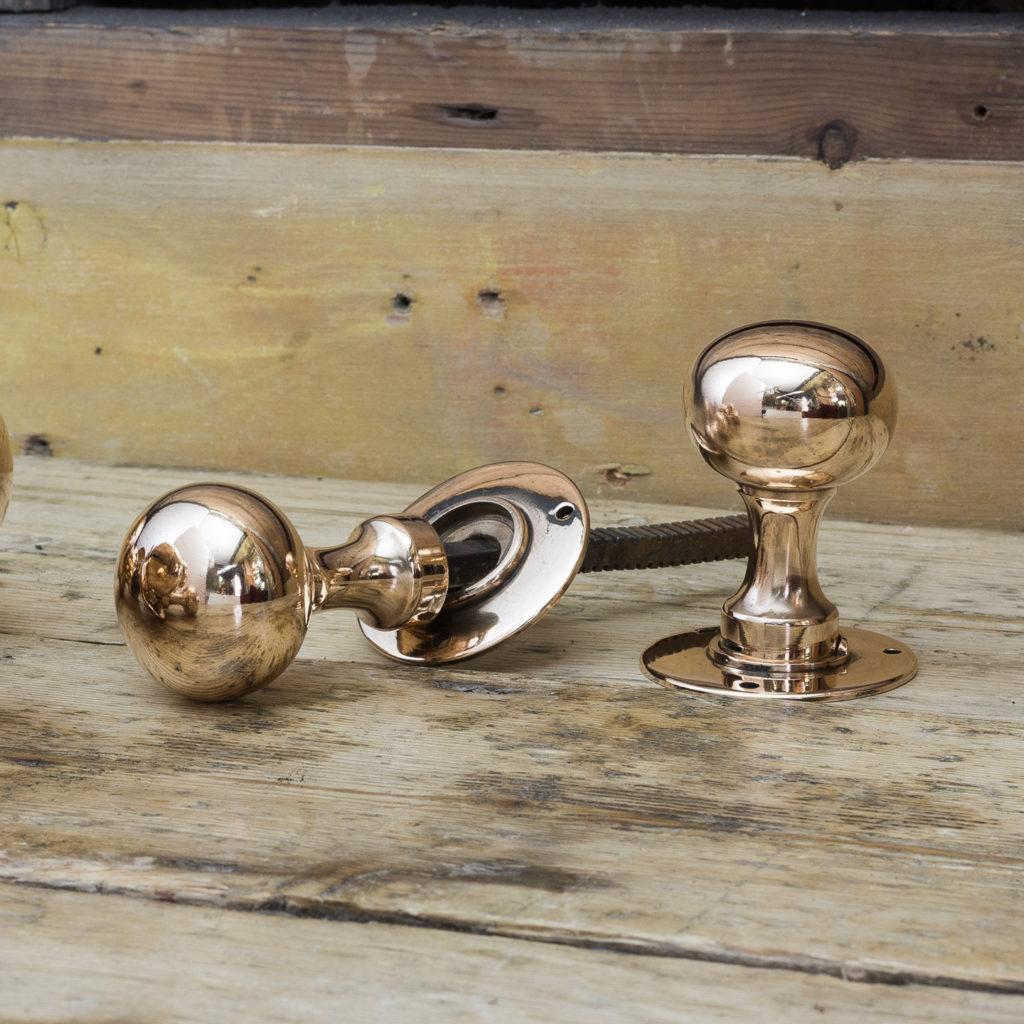Early twentieth century rose brass door knobs,-0