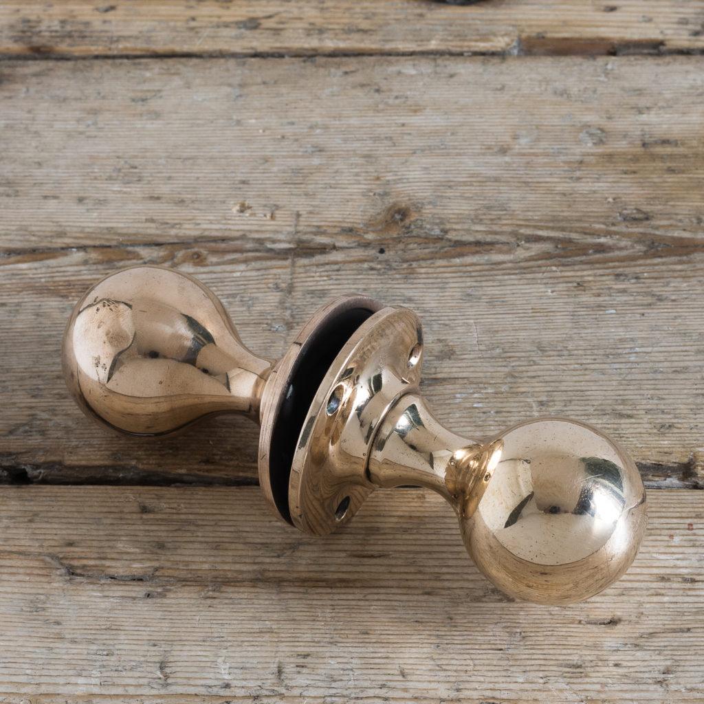 Early twentieth century rose brass door knobs,-122357