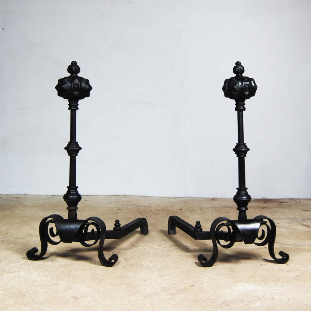 A pair of large cast and wrought iron Renaissance revival fire dogs-0