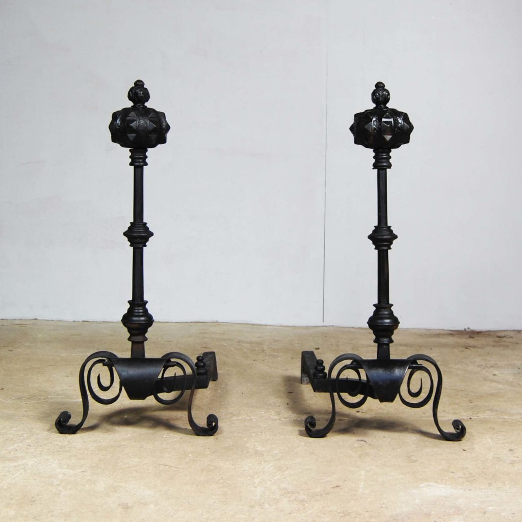 A pair of large cast and wrought iron Renaissance revival fire dogs-123357