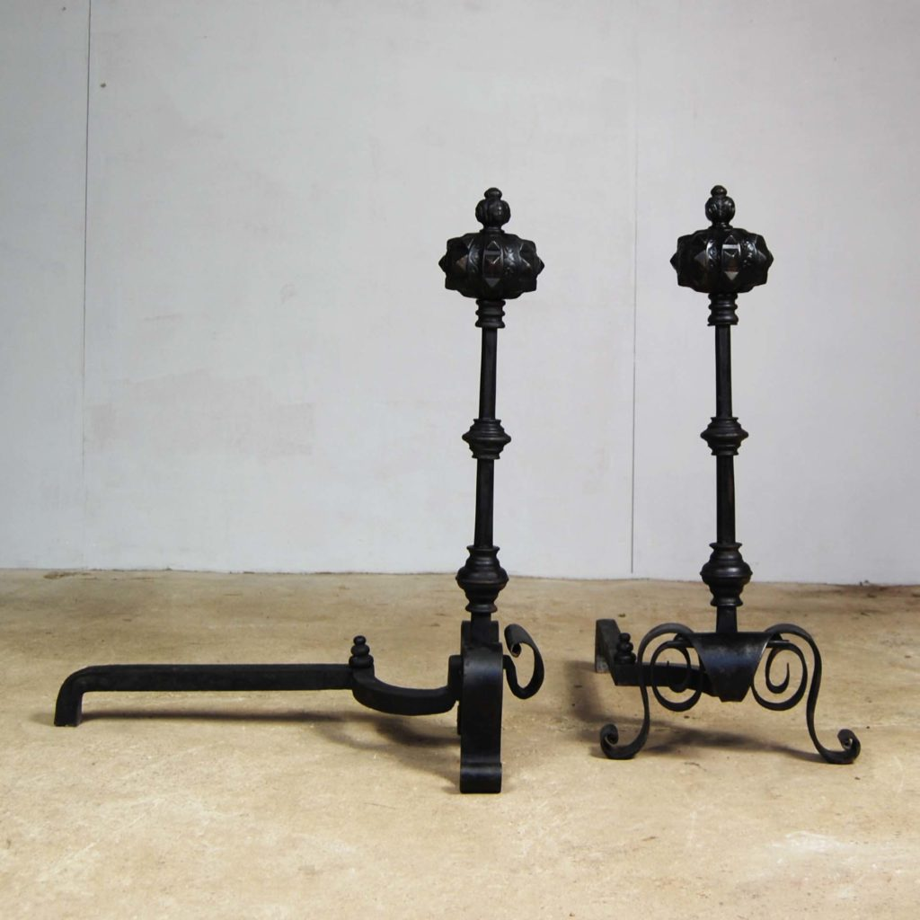 A pair of large cast and wrought iron Renaissance revival fire dogs-123359