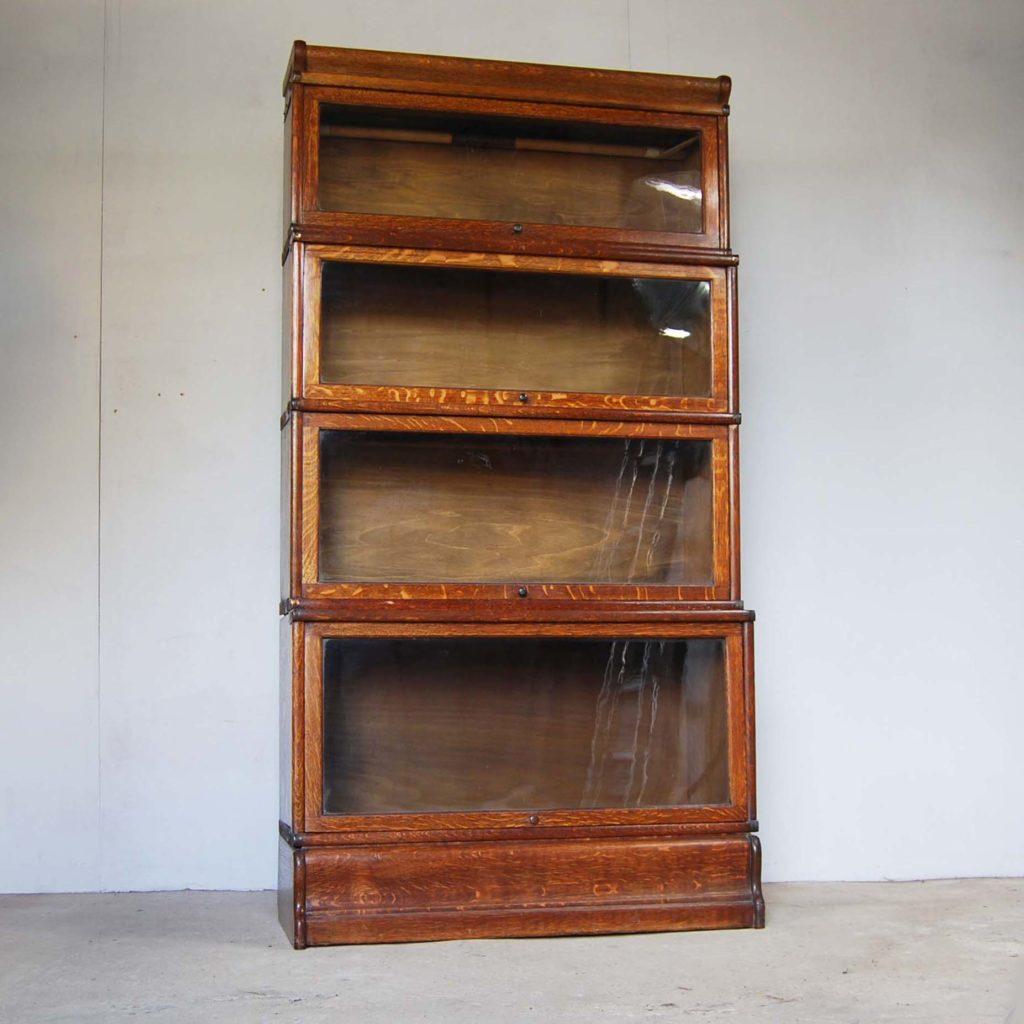 An English oak glazed sectional bookcase,-0