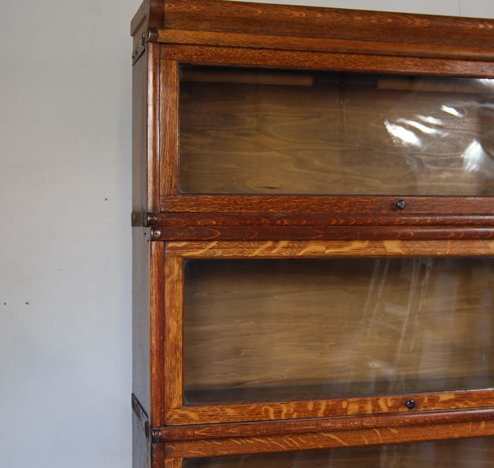 An English oak glazed sectional bookcase,-127751