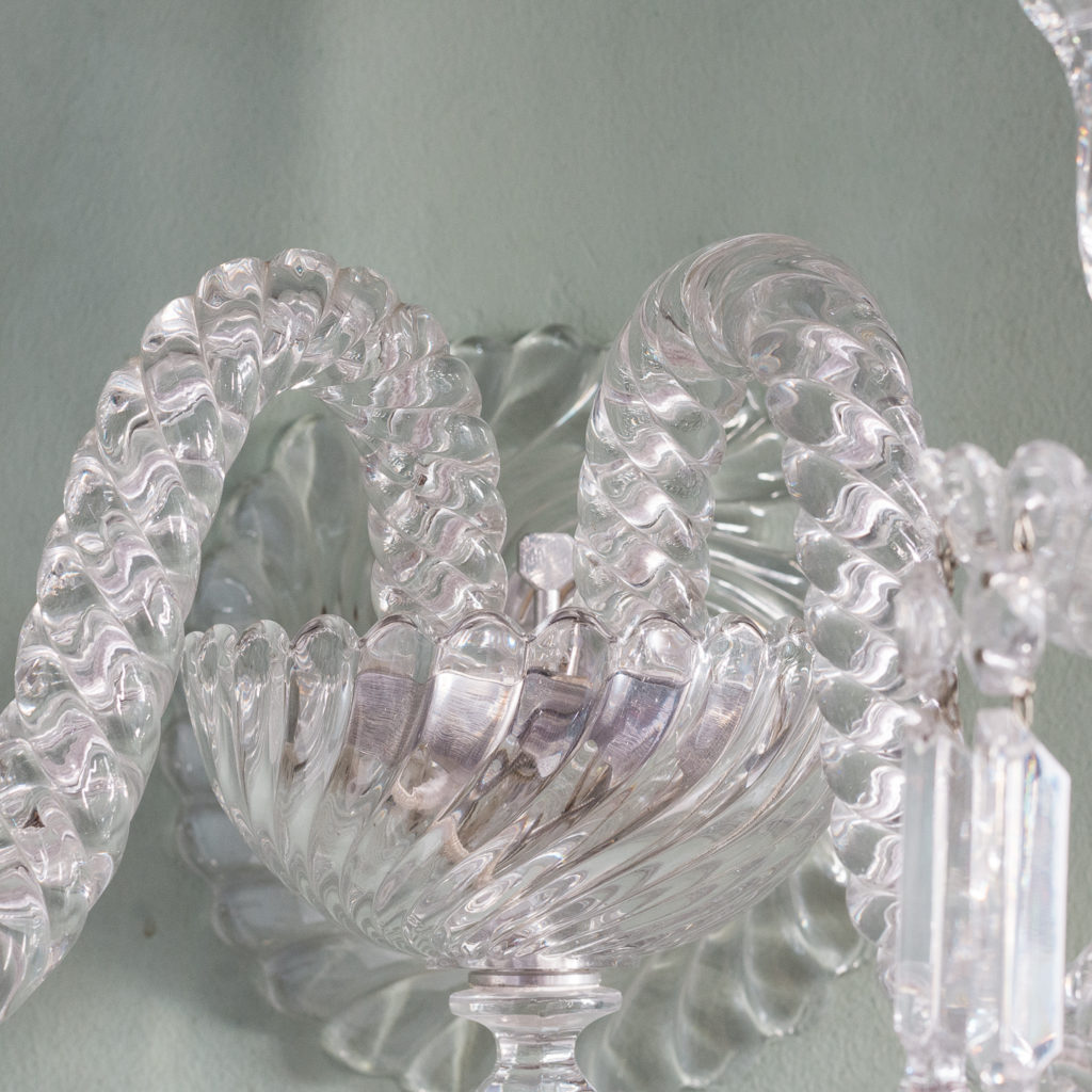 scallop-edged gadrooned bowl issuing two wrythen arms
