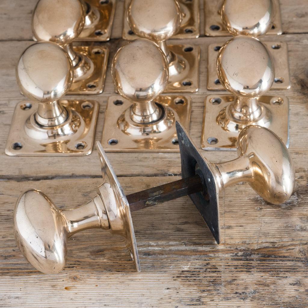 Early twentieth century rose brass door knobs,