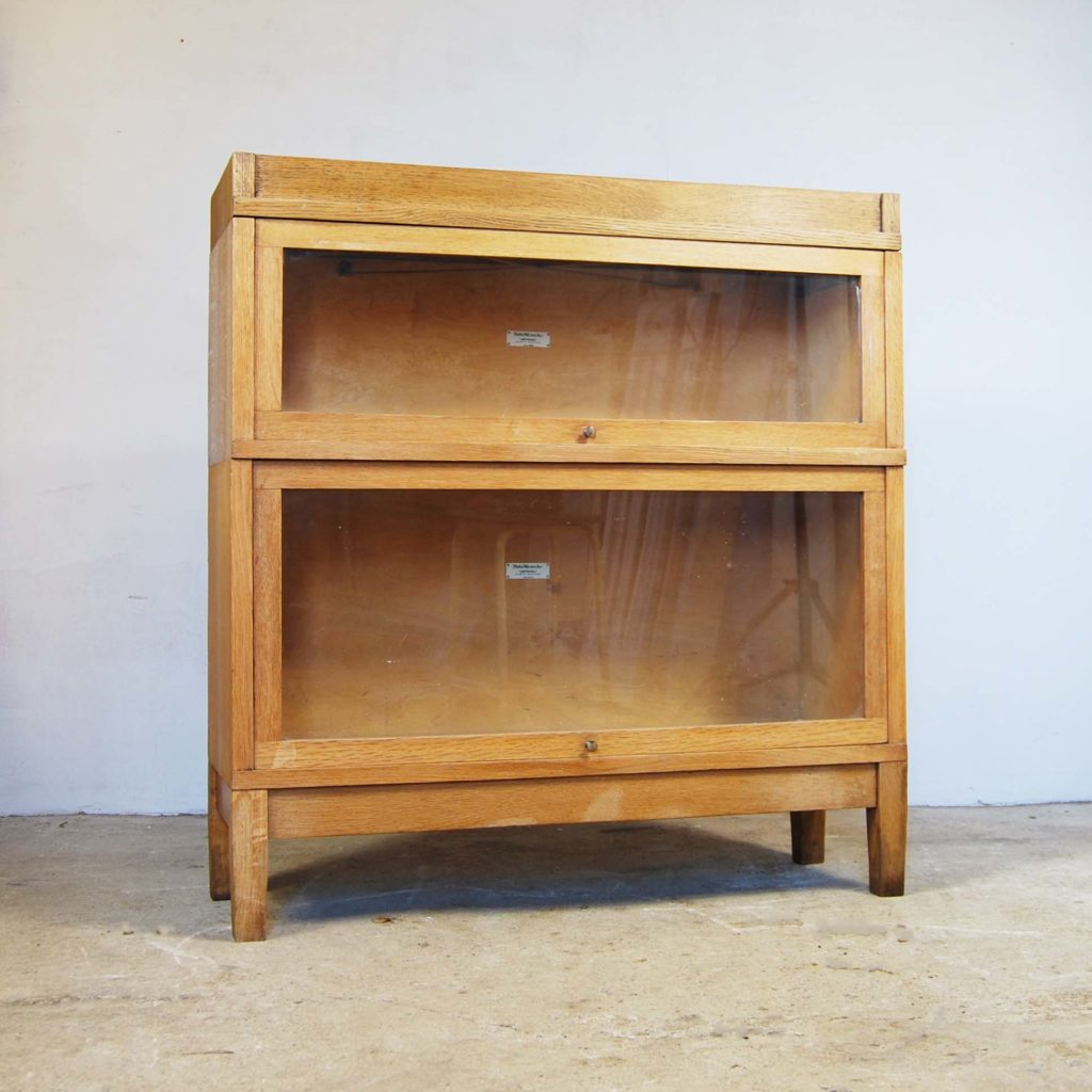 A blonde oak two stage sectional bookcase-0