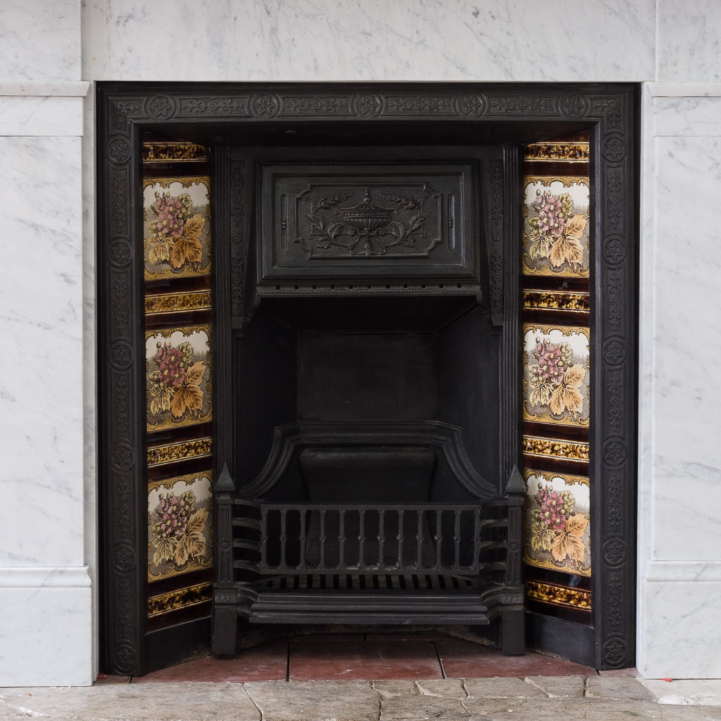 Late Victorian carrara marble chimneypiece and cast iron insert,