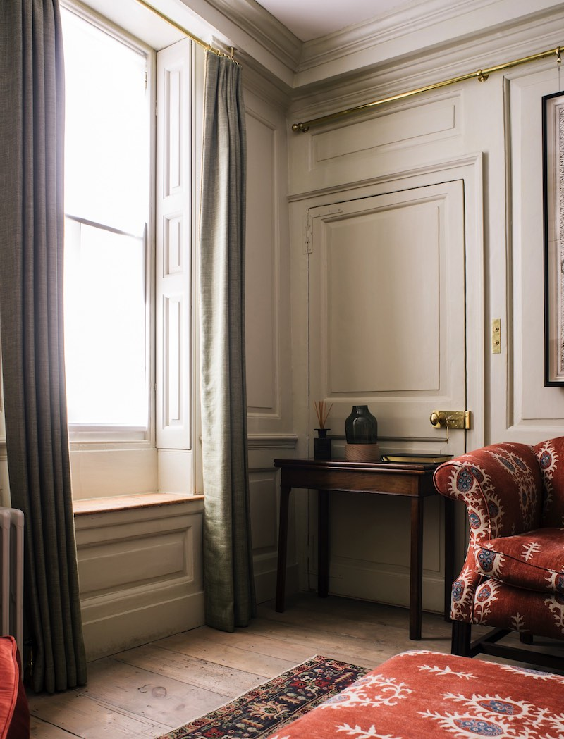 Period panelling showcases a well dressed interior complimented by reclaimed Georgian pine